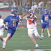 Chase Blumbergs works on defense for the Mustangs against Cazenovia.