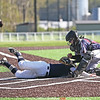 Seneca Indians catcher Derrick Lewis makes a tag-out at home plate, Wednesday, May 8.