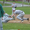 Dundee third baseman Zack Neu tags out a runner that over slid the base, last Wednesday.