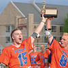 Penn Yan's Jack Peterson and Conner Fingar celebrate with the Section V trophy, Wednesday, May 29.