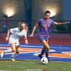 Marianna Dalglish defends the ball near the corner of the field.