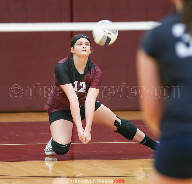 Abigail Miller records a dig for Dundee against Mynderse.