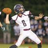 Cameron Holland prepares to throw a pass Friday, Sept. 13.