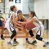 Jenna Solomon and Aislinn Klemann force a jump ball in the game last Friday.