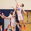 Kyle Berna jumps high to grab a rebound against Wayne.