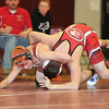 Jacob Shimer tries to flip over his opponent in the match last week.