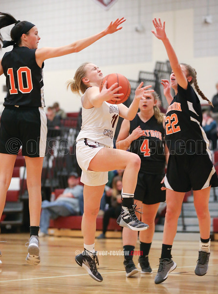 Autumn Garrison is fouled as she goes to the basket in the game against Marathon.