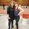 Watkins Glen track coach Kelly Sterner and Madelyn Suddaby pose for a photo at Cortland last Friday.