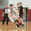 Owen Scholtisek drives to the basket in the game against Wellsville last week.