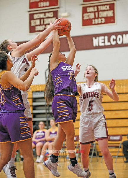Hallie Knapp and Savannah Eaves defend as a Sodus player goes to the basket, Monday, Jan. 6.