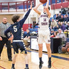 Mitchell Pike shoots for Watkins Glen in the game Tuesday, Feb. 11.