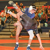 Ayden Mowry takes down his challenger in the bout last week.