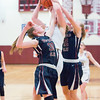 Jenna Solomon and Kelsey Kernan foul JoLynn Minnier in the basketball game Wednesday, Jan. 29.