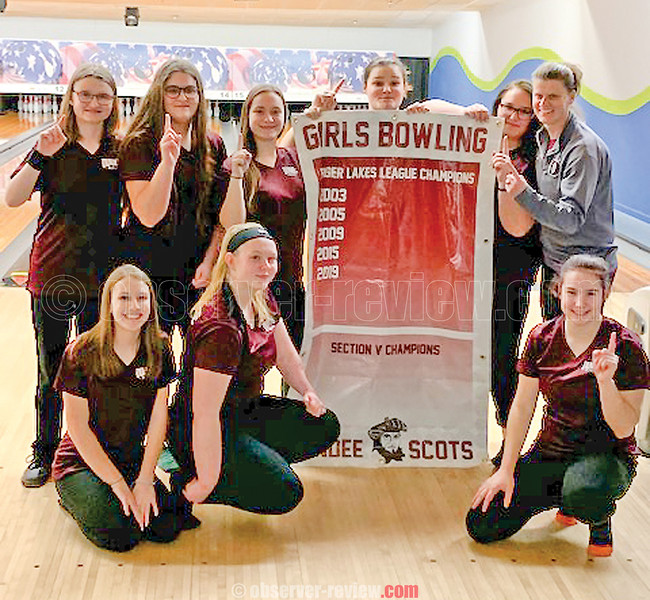 The Dundee girls bowling team celebrates with their championship banner, Monday, Feb. 3. PHOTO PROVIDED