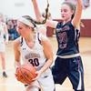 Grace Vondracek pulls down a rebound as Jenna Solomon defends last week.