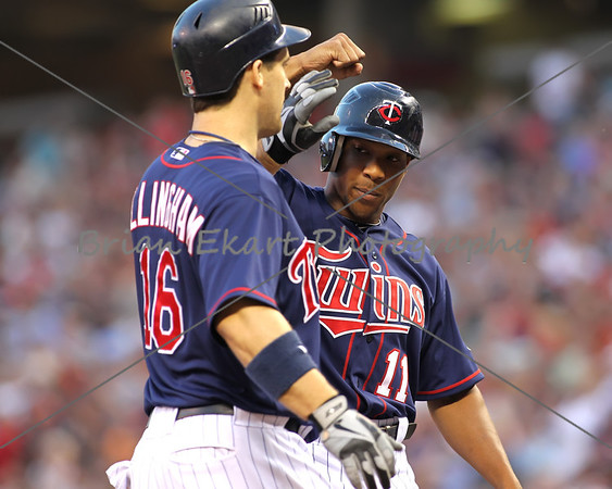 Minnesota Twins outfielder Ben Revere (11) congratulates Minnesota Twins outfielder Josh Willingham (16) after hitting a three homerun in the fourth inning on July 27, 2012:  during the Minnesota Twins game versus the Cleveland Indians at Target Field in Minneapolis, MN.   Minnesota Twins 11 and Cleveland Indians 0.
