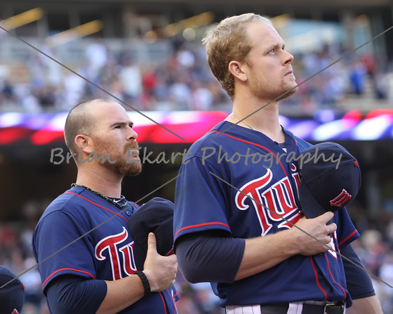 Minnesota Twins infielder Justin Morneau (33) along with Minnesota Twins catcher Ryan Doumit (18) during the national anthem on July 27, 2012:  during the Minnesota Twins game versus the Cleveland Indians at Target Field in Minneapolis, MN.