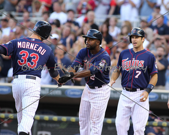Minnesota Twins infielder Justin Morneau is congratulated by Minnesota Twins outfielder Dendard Span (2) and Minnesota Twins catcher Joe Mauer (7) after hitting a three run homerun in the first inning on July 27, 2012:  during the Minnesota Twins game versus the Cleveland Indians at Target Field in Minneapolis, MN.