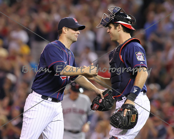 Minnesota Twins catcher Joe Mauer (7) congratulates Minnesota Twins pitcher Scott Diamond (58) after pitching a complete game three hit shut out on July 27, 2012:  during the Minnesota Twins game versus the Cleveland Indians at Target Field in Minneapolis, MN.  Minnesota Twins 11 and Cleveland Indians 0.