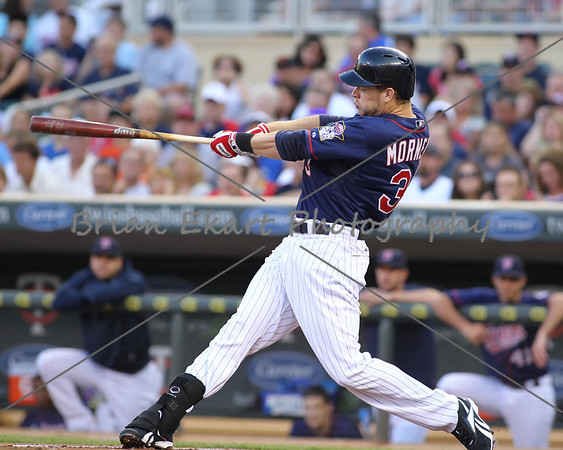 Minnesota Twins infielder Justin Morneau hits a three run homerun in the first inning on July 27, 2012:  during the Minnesota Twins game versus the Cleveland Indians at Target Field in Minneapolis, MN.