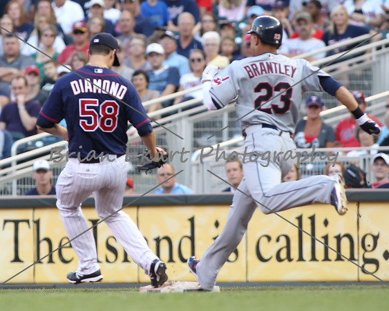 Minnesota Twins pitcher Scott Diamond (58) beats Cleveland Indians outfielder Michael Brantley (23) to first base for the out during the game on July 27, 2012:  during the Minnesota Twins game versus the Cleveland Indians at Target Field in Minneapolis, MN.  Minnesota Twins 11 and Cleveland Indians 0.