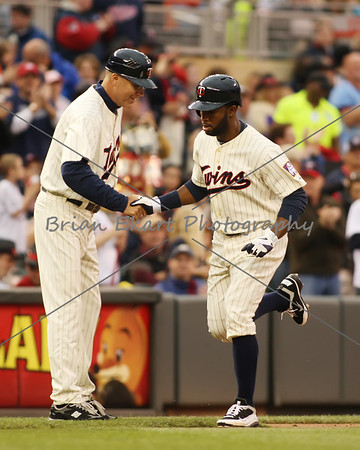 Minnesota Twins outfielder Dendard Span (2) celebrates with Steve Liddle the third base coach after hitting a homerun on May 26, 2012:  at the Minnesota Twins game versus the Detroit Tigers at Target Field in Minneapolis, MN.