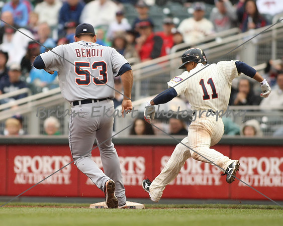 Minnesota Twins outfielder Ben Revere beats out Detroit Tigers pitcher Joaquin Benoit (53) to first base on May 26, 2012: at the Minnesota Twins game versus the Detroit Tigers at Target Field in Minneapolis, MN.   Detroit 6 and Minnesota 3.