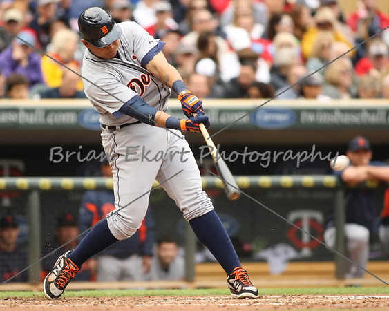Detroit Tigers infielder Miguel Cabrera (24) with a hit during the game on May 26, 2012:  during the Minnesota Twins game versus the Detroit Tigers at Target Field in Minneapolis, MN.