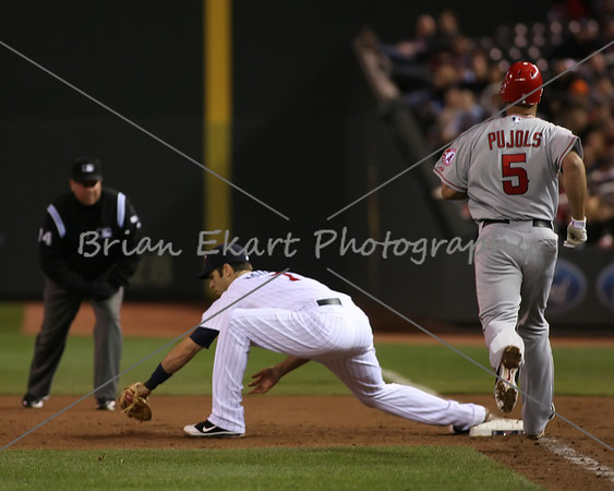Minnesota Twins catcher Joe Mauer (7) digs one out of the dirt while Los Angeles Angels infielder Albert Pujols (5) is out at first during the game on May 8, 2012:  at the Minnesota Twins game versus the Los Angeles Angels of Anaheim at Target Field in Minneapolis, MN.