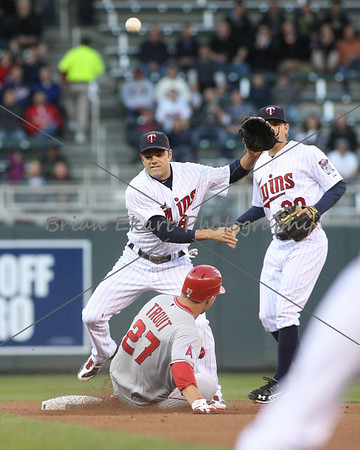 Minnesota Twins infielder Jamey Carroll (8) turns a double play in the first inning on May 8, 2012:  during the Minnesota Twins game versus the Los Angeles Angels of Anaheim at Target Field in Minneapolis, MN.