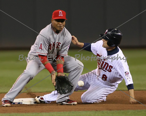 Minnesota Twins infielder Jamey Carroll (8) slides into second and is safe as Los Angeles Angels infielder Erick Aybar (2) waits for the ball to arrive during the game on May 8, 2012:  at the Minnesota Twins game versus the Los Angeles Angels of Anaheim at Target Field in Minneapolis, MN.