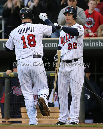 Minnesota Twins catcher Ryan Doumit (18) celebrates with Minnesota Twins infielder Danny Valencia (22) after his home run during the game on May 8, 2012:  at the Minnesota Twins game versus the Los Angeles Angels of Anaheim at Target Field in Minneapolis, MN.