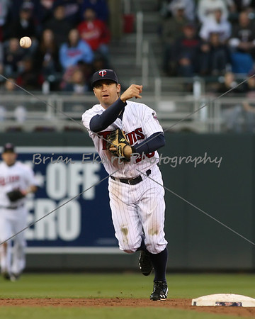 Minnesota Twins infielder Brian Dozier (20) makes a throw to first during the game on May 8, 2012:  at the Minnesota Twins game versus the Los Angeles Angels of Anaheim at Target Field in Minneapolis, MN.
