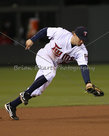 Minnesota Twins infielder Brian Dozier (20) makes a nice running grab during the game on May 8, 2012: at the Minnesota Twins game versus the Los Angeles Angels of Anaheim at Target Field in Minneapolis, MN.