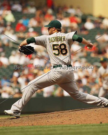 Oakland Athletics pitcher Evan Scribner (58) pitches during the game on July 15, 2012:  during the Minnesota Twins game versus the Oakland Athletics at Target Field in Minneapolis, MN.