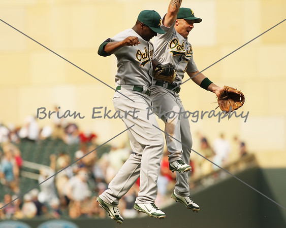 Oakland Athletics infielder Brandon Inge (7) and Oakland Athletics infielder Chris Carter (22) celebrate after winning the game and sweeping the Twins on July 15, 2012:  during the Minnesota Twins game versus the Oakland Athletics at Target Field in Minneapolis, MN.