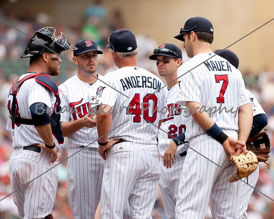 Rich Anderson pitching coach for the Minnesota Twins have a discussion with Minnesota Twins pitcher Brian Duensing (52) while the infielders listen in on July 15, 2012:  during the Minnesota Twins game versus the Oakland Athletics at Target Field in Minneapolis, MN.