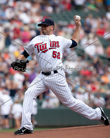 Minnesota Twins pitcher Brian Duensing (52) pitching during the first inning on July 15, 2012:  during the Minnesota Twins game versus the Oakland Athletics at Target Field in Minneapolis, MN.