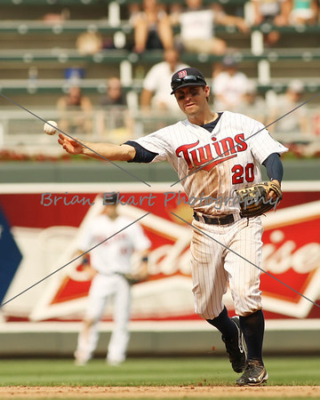 Minnesota Twins infielder Brian Dozier (20) throws out a runner during the game on July 15, 2012:  during the Minnesota Twins game versus the Oakland Athletics at Target Field in Minneapolis, MN.