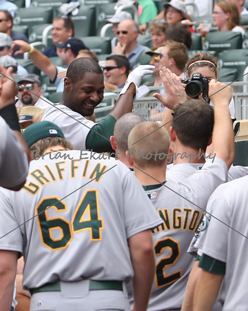 Oakland Athletics infielder Chris Carter (22) celebrates with teammates in the dugout after hitting a home run in the second inning on July 15, 2012:  during the Minnesota Twins game versus the Oakland Athletics at Target Field in Minneapolis, MN.