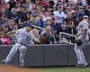 Toronto Blue Jays infielder Brett Lawrie (13) and Toronto Blue Jays outfielder Eric Thames (14) watch as the ball comes out of Toronto Blue Jays infielder Brett Lawrie (13)  glove during the May 12, 2012: at the Minnesota Twins game versus the Toronto Blue Jays at Target Field in Minneapolis, MN.