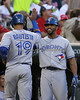 Toronto Blue Jays outfielder Jose Bautista (19) celebrates with Toronto Blue Jays outfielder Eric Thames (14) after he hit the game winning home run on May 12, 2012:  during the Minnesota Twins game versus the Toronto Blue Jays at Target Field in Minneapolis, MN.