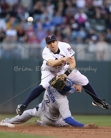Toronto Blue Jays infielder Kelly Johnson (2) slides under Minnesota Twins infielder Brian Dozier (20) during the game on May 12, 2012: at the Minnesota Twins game versus the Toronto Blue Jays at Target Field in Minneapolis, MN.