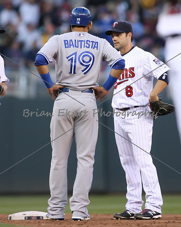 Toronto Blue Jays outfielder Jose Bautista (19) waits on second talking to Minnesota Twins infielder Jamey Carroll (8) while his hit was under review which was eventually called a homerun on May 12, 2012:  at the Minnesota Twins game versus the Toronto Blue Jays at Target Field in Minneapolis, MN.