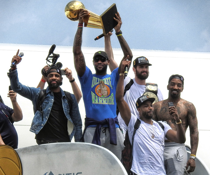 From left, Kyrie Irving, Lebron James, Kevin Love, Tristan Thompson and JR Smith come off the plane with the Larry O'Brien Trophy. BRUCE BISHOP/CHRONICLE