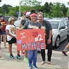ASHLEY FOX / CHRONICLE <br /> Lorain resident Nazaryah Perez, 11, holding a sign she made, waits Wednesday morning with her mother, Viviana, at the RTA depot on West 150th Street in Cleveland for a public transit ride to downtown to attend the parade and rally celebrating the NBA champion Cleveland Cavaliers.