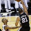 San Antonio Spurs power forward Tim Duncan (21) dunks on the Miami Heat during the first half of Game 6 of the NBA Finals basketball game, Tuesday, June 18, 2013 in Miami. (AP Photo/Wilfredo Lee)