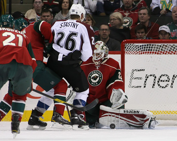 Minnesota Wild goalie Niklas Backstrom (32) with a pad save during period two at the Excel Energy Center in Saint Paul, MN while Colorado Avalanche forward Paul Stastny (26) watches.   MN Wild 2 and Colorado Avalanche 1.