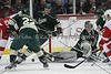 Minnesota Wild goalie Darcy Kuemper (35) with a pad save as players look for the loose puck during period one.  On February 17 at the Minnesota Wild game versus Detroit Red Wings at the Excel Energy Center in Saint Paul, MN.
