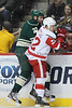 Detroit Red Wings forward Jordin Tootoo (22) checks Minnesota Wild forward Mike Rupp (27) into the boards during period one.  On February 17 at the Minnesota Wild game versus Detroit Red Wings at the Excel Energy Center in Saint Paul, MN.
